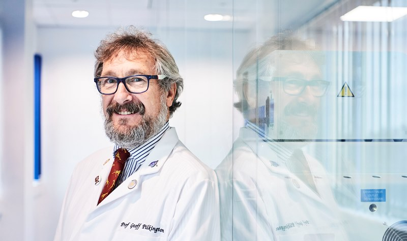 Photo of Professor Geoff Pilkington, brain tumour researcher, in his labcoat.
